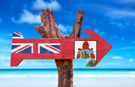 Bermuda flag sign with arrow on beach background Stock Photo