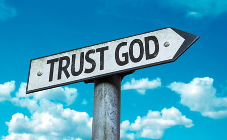 trust in god: Trust God sign with clouds and sky background Stock Photo