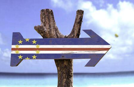 cape verde flag: Cape Verde flag sign with arrow on beach background