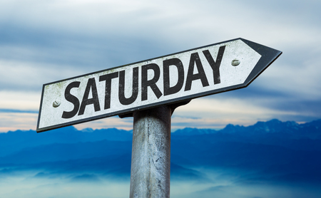 Saturday sign with sky background Фото со стока