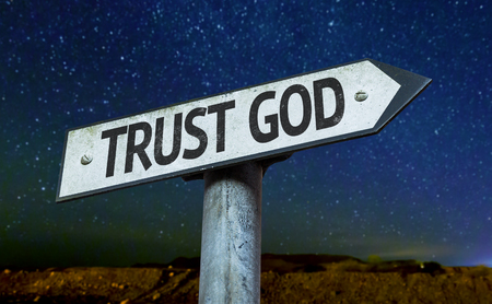 trust in god: Trust God sign with night sky background Stock Photo