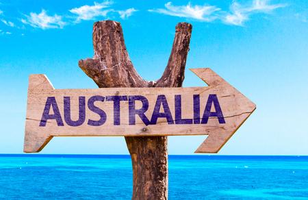 arrow sign: Australia sign with arrow on beach background