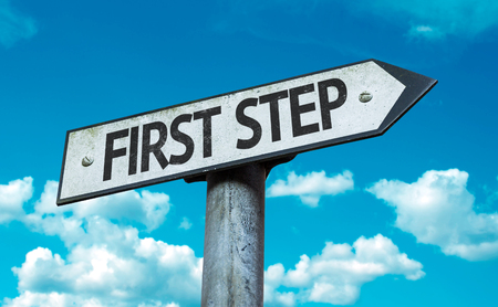 First step sign with clouds and sky background