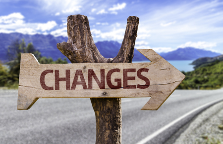 Changes sign with arrow on road background Stock Photo