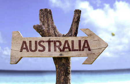 Australia sign with arrow on beach background