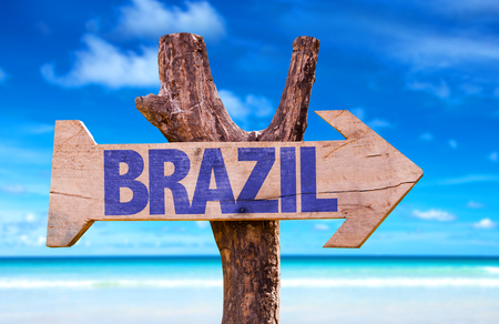Brazil sign with arrow on beach background