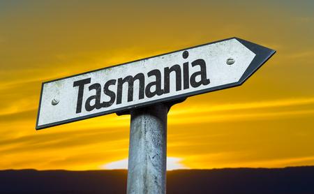 tasmania: Tasmania sign with sunset background