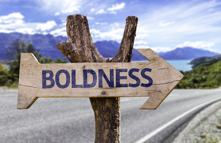 boldness: Boldness sign with arrow on road background