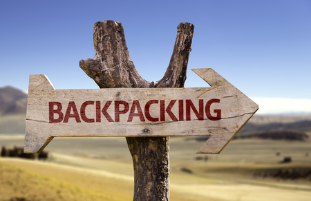 backpacking: Backpacking sign with arrow on desert background Stock Photo