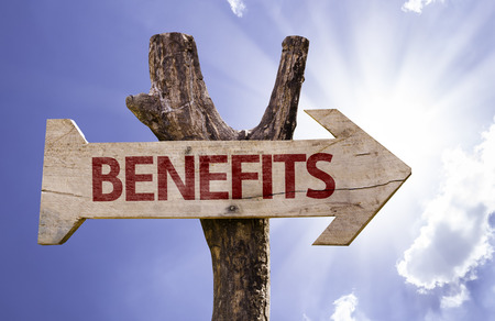 Benefits sign with arrow on sunny background Stock Photo
