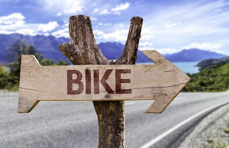 road bike: Bike sign with arrow on road background Stock Photo