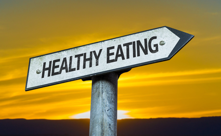 living wisdom: Healthy eating sign with sunset background