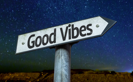 positivism: Good vibes sign with night sky background