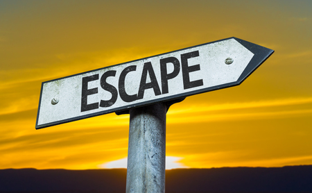 escape: Escape sign with sunset background