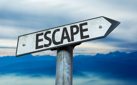 escape: Escape sign with sky background Stock Photo