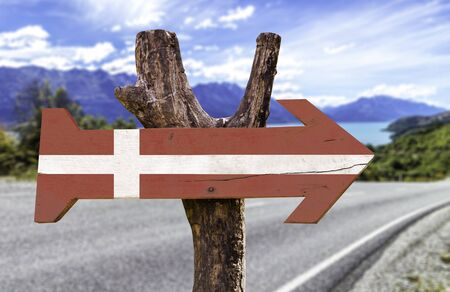 Denmark flag sign with arrow on road background Stock Photo