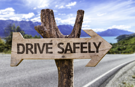 safely: Drive safely sign with arrow on road background