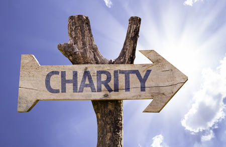 Charity sign with arrow on sunny background