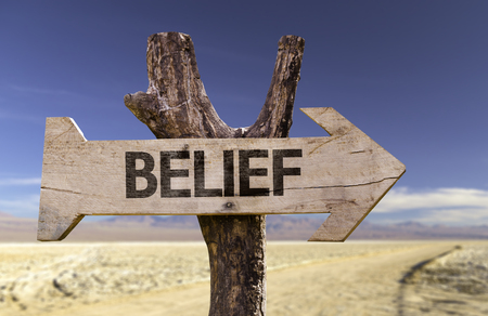 belief: Belief sign with arrow on desert background