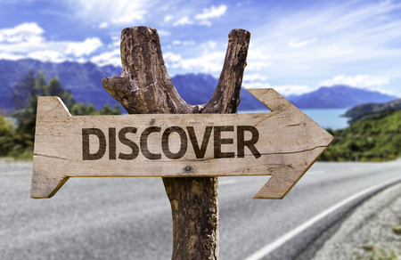 discover: Discover sign with arrow on road background