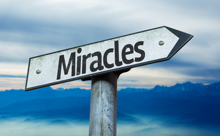 positivism: Miracles sign with sky background