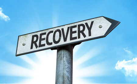 Recovery sign with sunny background