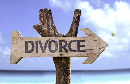 Divorce sign with arrow on beach background
