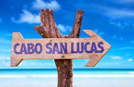 lucas: Cabo San Lucas sign with arrow on beach background