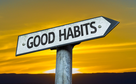 Good habits sign with sunset background