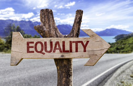 Equality sign with arrow on road background Stock Photo