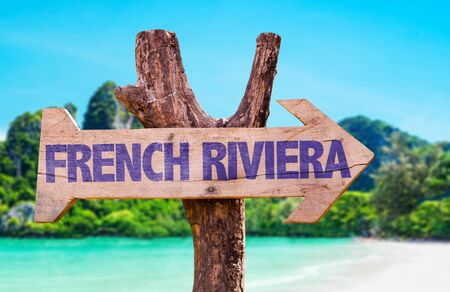 french riviera: Wooden sign board in wetland with text: French Riviera Stock Photo