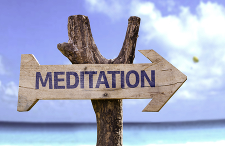 equilibrium: Meditation sign with arrow on beach background