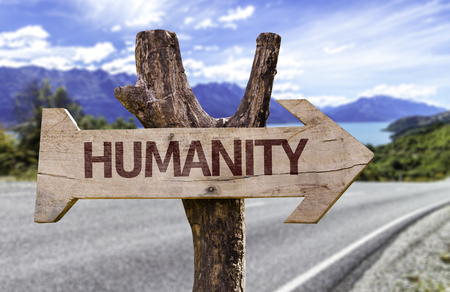 Humanity sign with arrow on road background