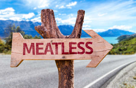 meatless: Meatless sign with arrow on road background