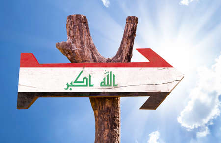 Iraq flag sign with arrow on sunny background Stock Photo