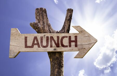 unveil: Launch sign with arrow on sunny background