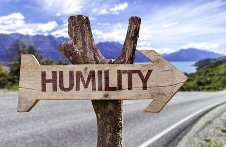 humility: Humility sign with arrow on road background Stock Photo