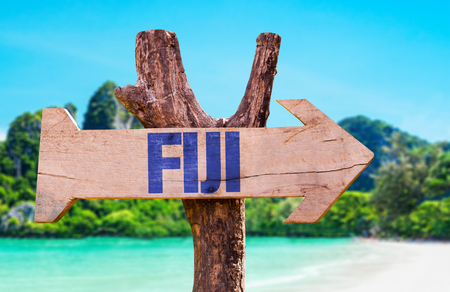 Wooden sign board in wetland with text: Fiji