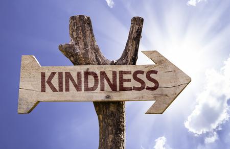 Kindness sign with arrow on sunny background Standard-Bild