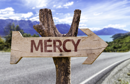 mercy: Mercy sign with arrow on road background