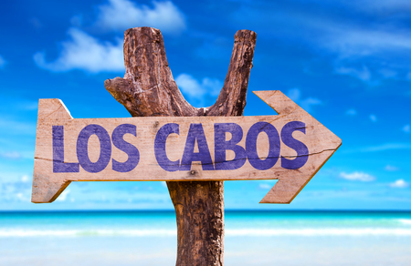 Los Cabos sign with arrow on beach background Stock Photo