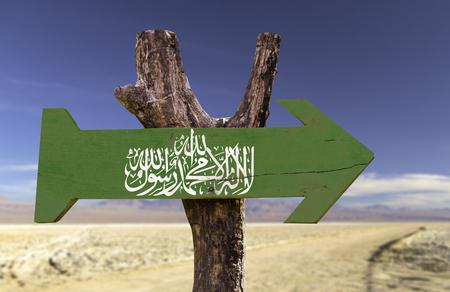 Hamas flag sign with arrow on desert background