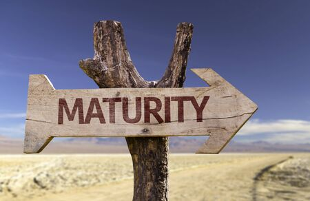 Maturity sign with arrow on desert background