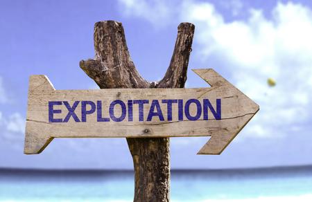 Exploitation sign with arrow on beach background