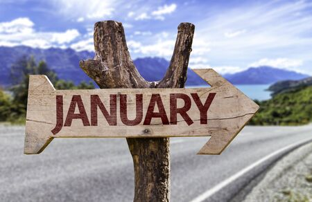 January sign with arrow on road background