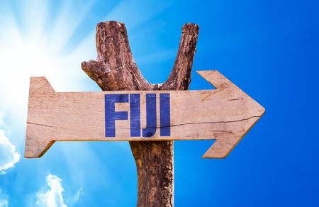 Fiji sign with arrow on sunny background