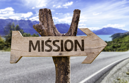 Mission sign with arrow on road background
