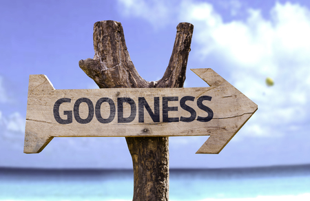goodness: Goodness sign with arrow on beach background Stock Photo