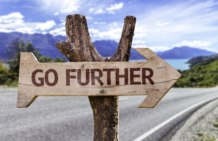 Go further sign with arrow on road background