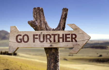 Go further sign with arrow on desert background